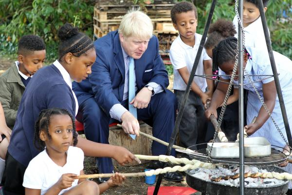 Boris Johnson met some children at the launch of the food borough project. Picture by Kois Miah