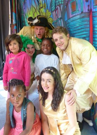 Cast members of Robinson Crusoe meet children at Croydon University Hospital