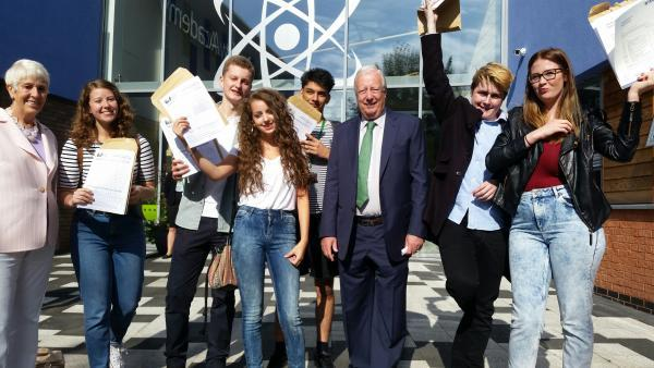 Students at Harris City Academy Crystal Palace celebrate their results with Lord Harris of Peckham, chairman of the Harris Federation
