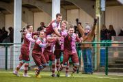 Late drama: Corinthian Casuals midfielder Dave Hodges, right, is mobbed after his stoppage time winner on Saturday 	Stuart Tree