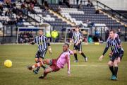 On target: Carl Wilson-Denis fires home for Corinthian Casuals at Imperial Fields on Saturday