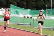 Sprint finish: Walton's Fiona De Mauny (26) streaks home for senior women's 800m gold at Kingsmeadow on Saturday. De Mauny also claimed 1,500m and 3,000m silver