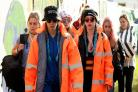Here's Cara Delevingne and Suki Waterhouse attempting to blend in with the crowd at Glastonbury