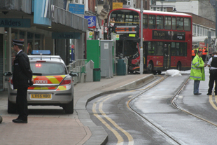 Man killed after bus and tram collide