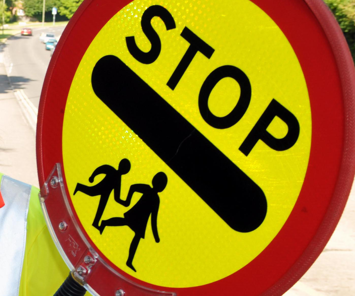 A lollipop woman is more of a hindrance than a help, at least for motorists