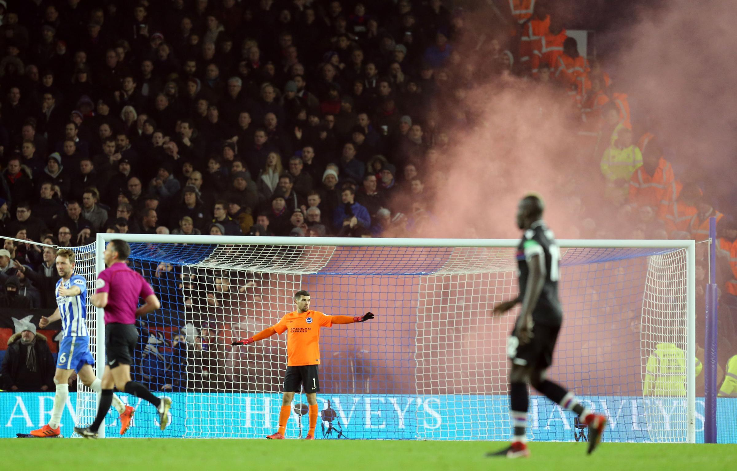 Crystal Palace fans let off smoke bombs in the stands during the Brighton game | Picture: PA