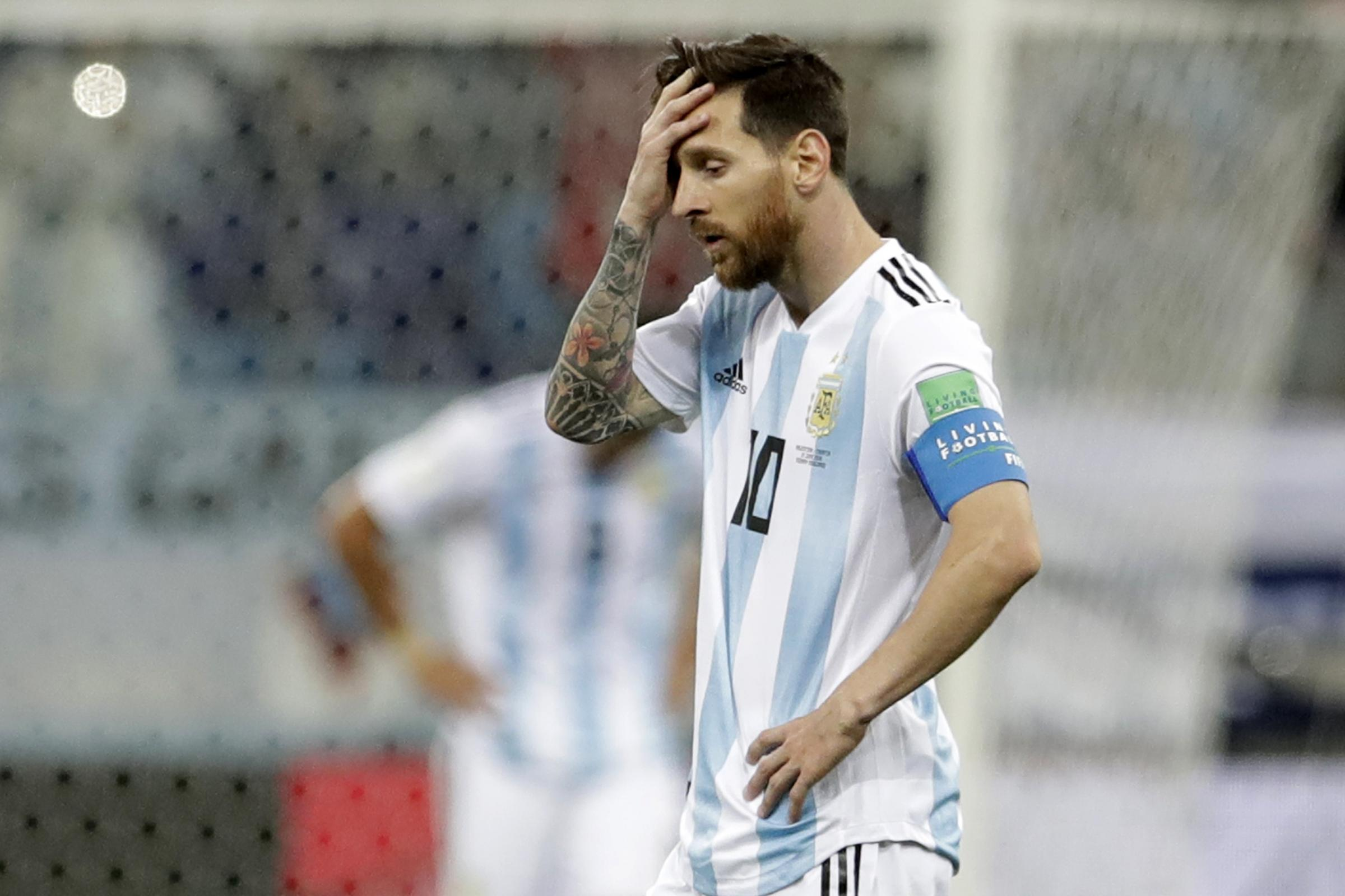 Lionel Messi and Argentina are facing elimination (Petr David Josek/AP)